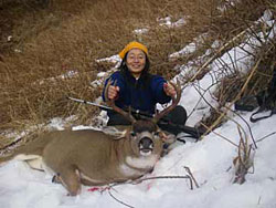 Hunter with deer