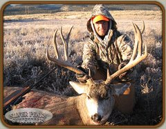Hunter with his dandy trophy Colorado Mule Deer taken at our Hunting Camp #6