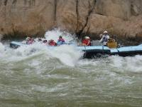 image showing a boat going through rapids