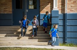photo - Students run out of Helen Hunt Elementary School after the bell rings on Friday, October 9, 2015. Helen Hunt Elementary School faces potential closure and relocation to Adams Elementary School, which was closed in 2009 instead of Helen Hunt Elementary. Photo by Stacie Scott, The Gazette